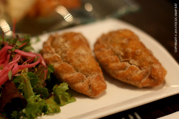 Empanadas de pato are duck confit picadillo empanadas with smoked duck ham and aji verde sauce ($8)