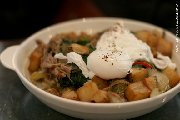 Hash & Eggs ($10) with kalua pig, potatoes, peppers, onions, celery and a poached egg.