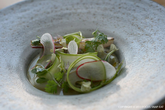 Spring onion curd with artichoke and spring flora, and roasted crab broth