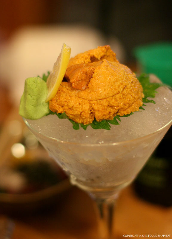 Sea urchin, or uni, served on ice in a cocktail glass