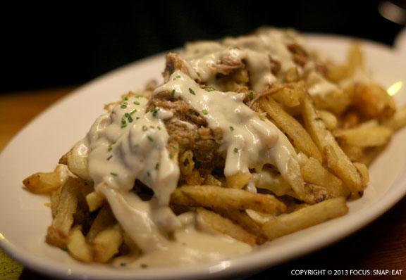 Guilty Fries ($15) is a twist on poutine with beer and cheddar fondue and pulled pork smothering the French fries.