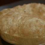 Cholle bhature is like a big puffer fish. This airy bread starts to deflate at the table and you rip it apart and dip it in a sauce