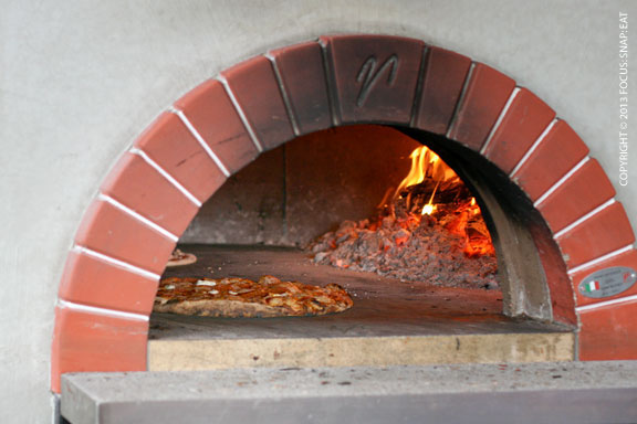 Wood-fire oven with pizza made to order