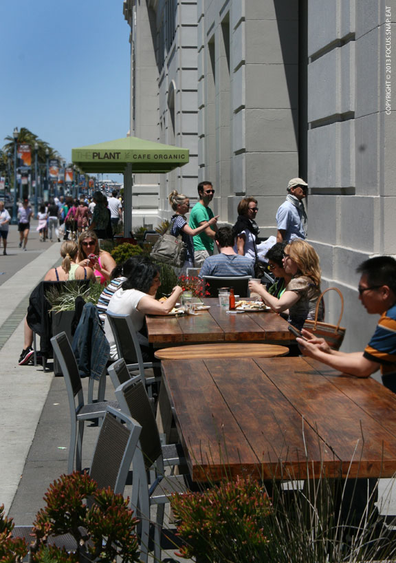 On a beautiful day, the Plant Cafe's outdoor seating is a popular spot
