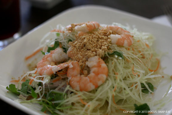 Goi, or green papaya salad with shrimp, julienned pork, carrots, mint and roasted peanuts ($6.50) is quite filling, with extremely julienned green papaya.