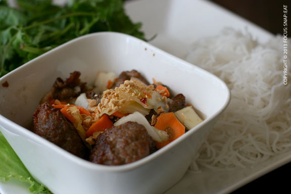 But chat thit nuong or marinated grilled pork and meatballs served with fresh herbs, rice vermicelli and fish sauce ($11)