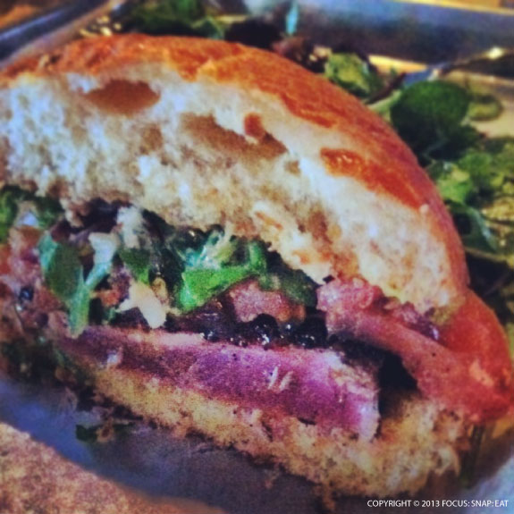 The ahi burger ($14) is one of the bright spots on the bar menu at Hi Tops. Look at the perfectly cooked rare tuna.