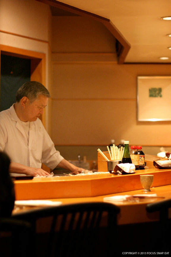 Chef Toshiaki Kimura comes out to put final preps to dishes that his wife serves.