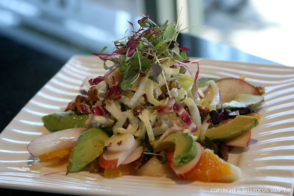 Towering summer salad with figs, white peaches, avocado, tangerines and endive
