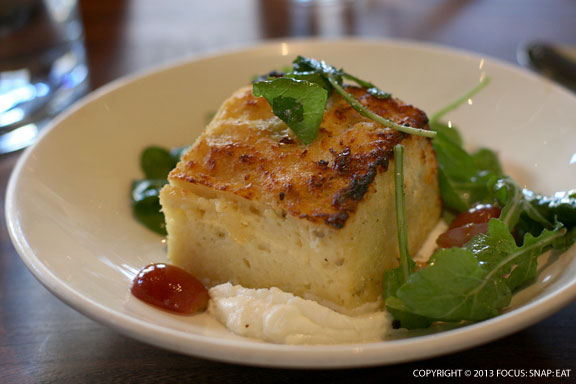 Goat cheese bread pudding with grapes and arugula ($9)
