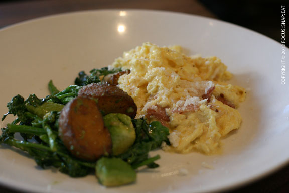 Soft scrambled eggs with tasso ham, broccoli di ciccio, crispy potato, avocado and parmesan ($13)