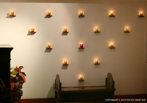 Votive candle display in the lobby of the Aqua Lotus Hotel