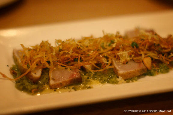 Seared kampachi crudo ($13), coriander-lime dusted Hawaiian kampachi, cilantro,garlic chips, pickled Serrano chimichurri