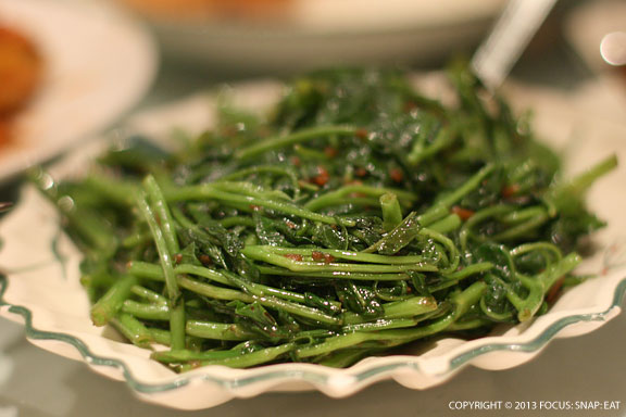 Belanchan kang kung is a favorite greens made with shrimp paste, a bit like young water greens.