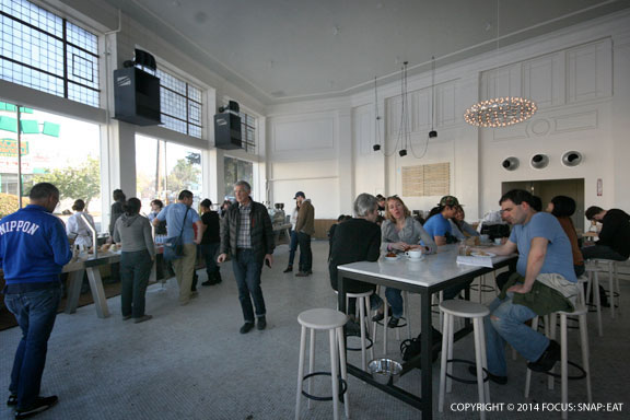 Blue Bottle's new cafe in Oakland is one of its largest, with high ceilings and lots of natural light.