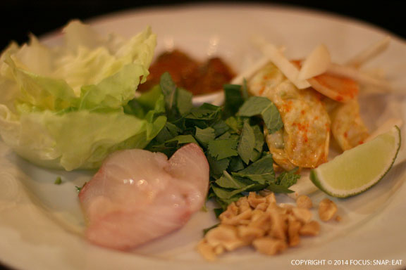 Kampachi crudo served Korean-style with spicy sauce, kim chi and lettuce cups, $12