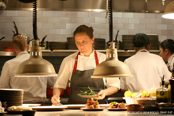 Chef April Bloomfield looking serious while prepping her dishes