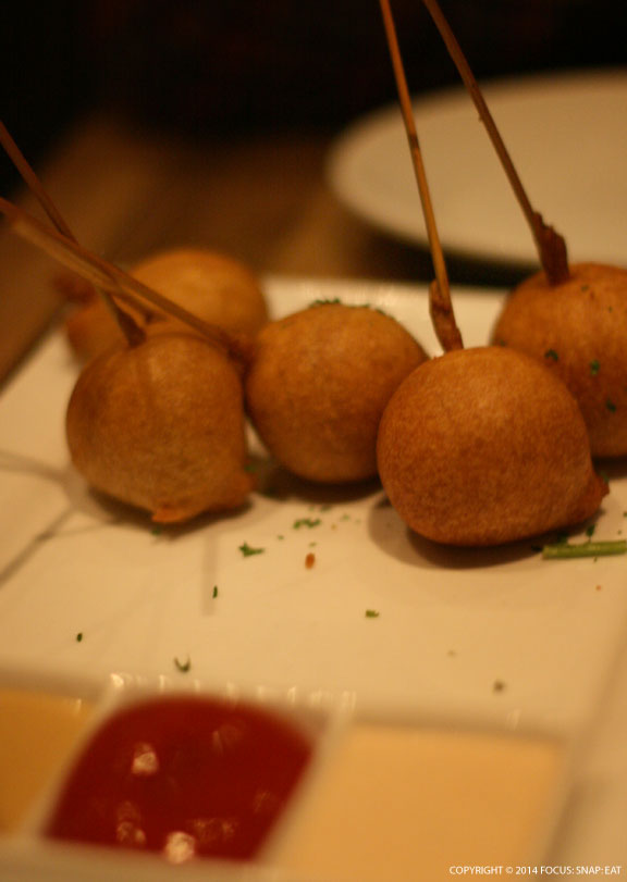Lollipop corn dogs ($7.50) with a trio of dipping sauces
