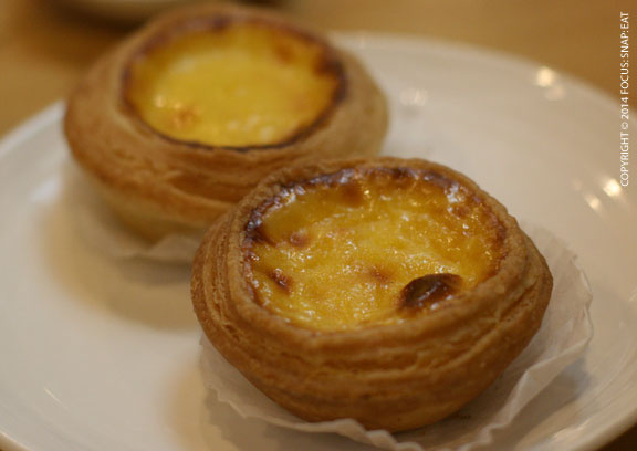 Macau-style egg tarts (bo tat) have a caramelized top and flakier crust compared to normal egg tarts (dahn tat)