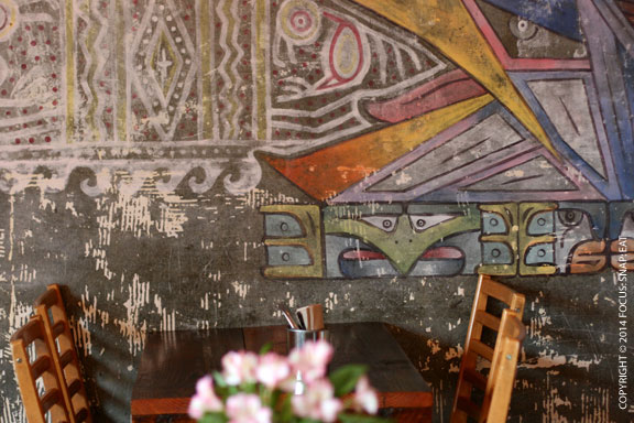 The colorful wall at the back of Nido's dining area