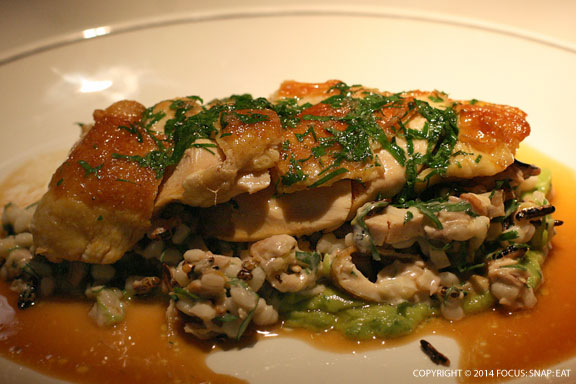 Corn-fed chicken breast, confit leg, puffed rice, pearl barley and sorrel (AUS$36 or $33.80)