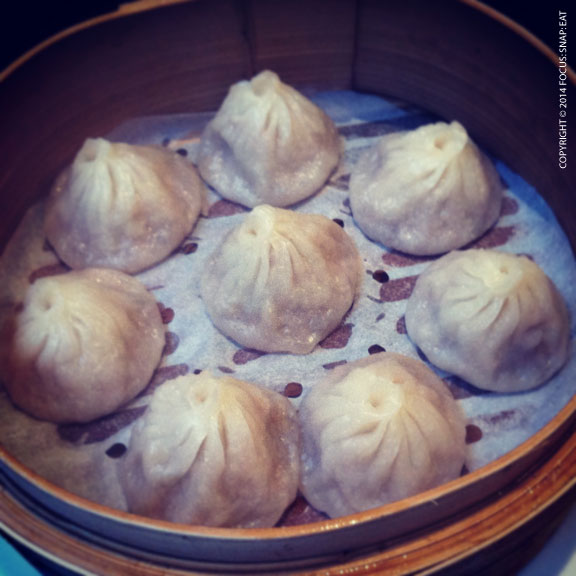 Xiao lung bao, or soup dumplings, were perfectly formed