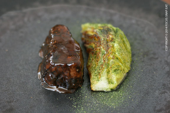 Marinated veal in a glaze with anchovies and wedge of cabbage.