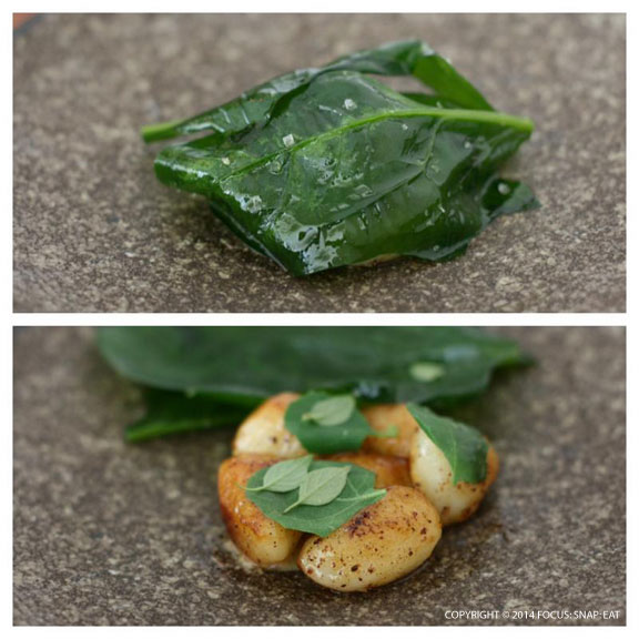 Potatoes with mustard came to the table nestled under a canopy of cooked spinach leaves.
