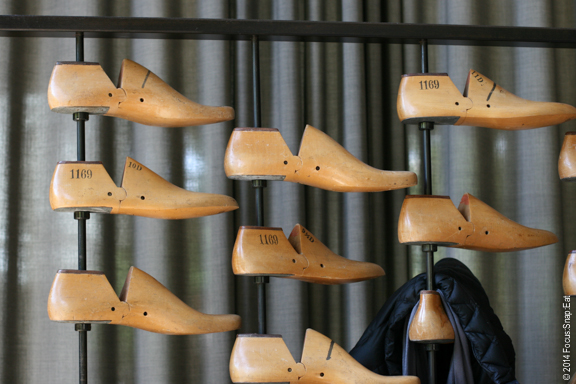 An unusual but creative rack of shoe holders at the entrance that was used as a coat hanger.