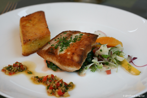 Wild Pacific sea bass with polenta, braised swiss chard, shaved fennel and orange salad