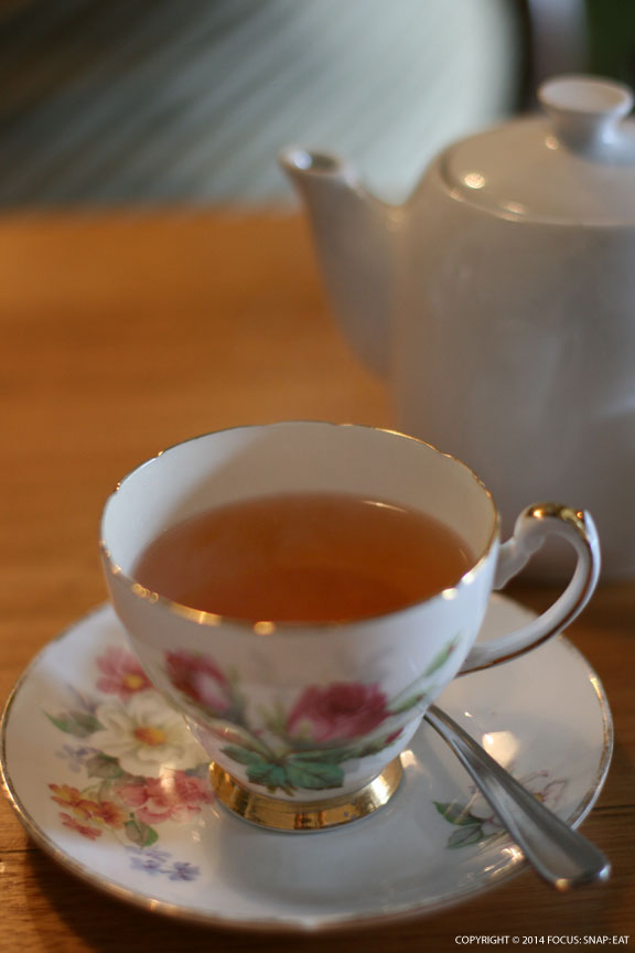 Enjoying a pot of Earl Grey tea, which just seems fitting for this British-styled restaurant