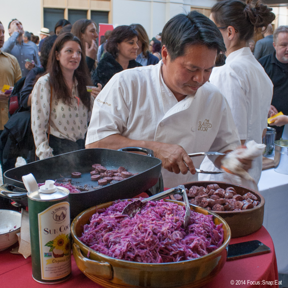 Charles Phan of the Slanted Door working his station and preparing his blood sausage and pickled cabbage dish.