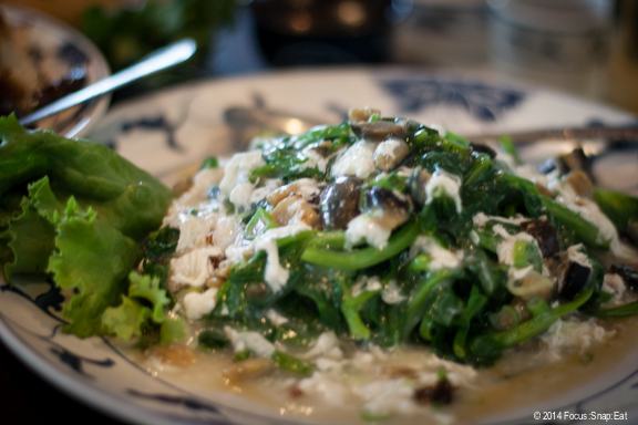 Sauteed snow pea leaves with century eggs, $14.95