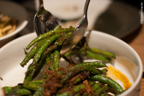 Serving up blistered green beans in XO sauce ($10).
