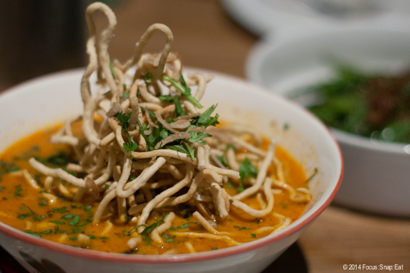 A new noodle dish we tried is called Khao Soi Gai ($15), which is egg noodles in a Northern-style chicken curry broth. I was intrigued by the menu listing pickled vegetables but turned out they were only served on the side. The bowl comes with a dramatic pile of fried noodles on top as a garnish.