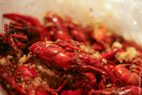 Two pound bag of crawfish comes to the table in a plastic bag.