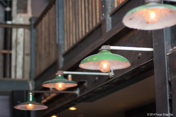 Cool lighting over the bar is some of the highlights that have given the bar's design a lot of recognition.