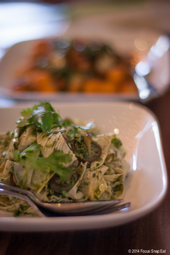 A cold dish of yuba salad ($9.50) made with the tofu skin called yuba from local Hodo Soy and tossed with a cilantro-ginger salsa verde. (In the background is the Korean-style rice cakes dish).