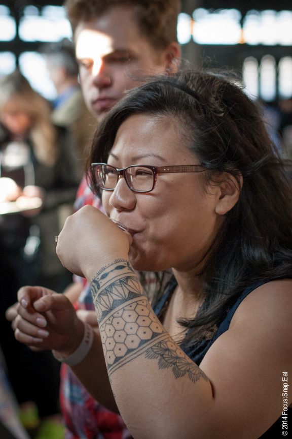 I ran into fellow food blogger Brenda T. of Bites and Bourbon. Here she's taking a shot of vodka from the Anda Piroshki table. Anda required everyone to take a shot of vodka before trying her bite. I did the same and really felt the vodka made the bite taste better.
