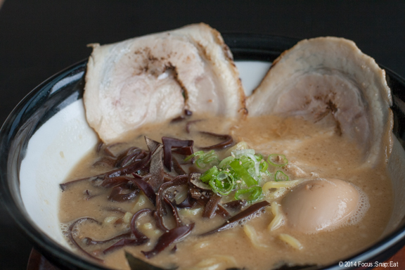 Kuro Ramen ($8.95) with two thinly sliced chashu (pork), boiled egg, kikurage mushroom, negi, and seaweed with tonkotsu broth with a soy sauce base.