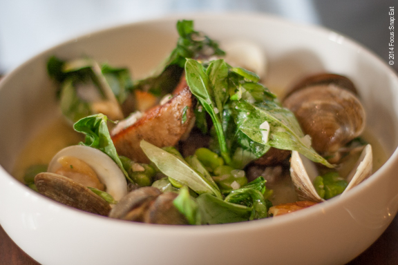 Slow-cooked pork shoulder with clams, fava, and crushed potatoes ($23)