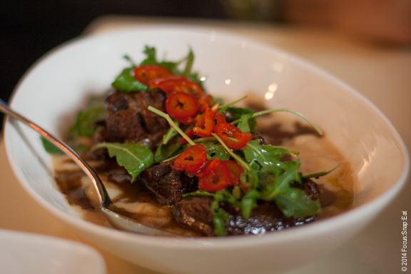 Chili-chocolate braised short ribs with wild arugula, pickled fresno chilies and butter beans, $19