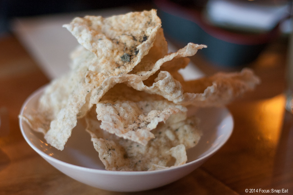 Starter of puffed brown rice crackers with umami powder ($5)