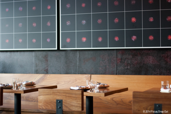 Ume's decor remains the same as it did under Plum, with plum photo artwork and clean wooden tables and seating.