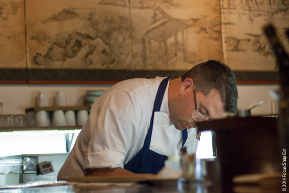 Chef Trent Pierce can be seen working hard behind the bar counter.