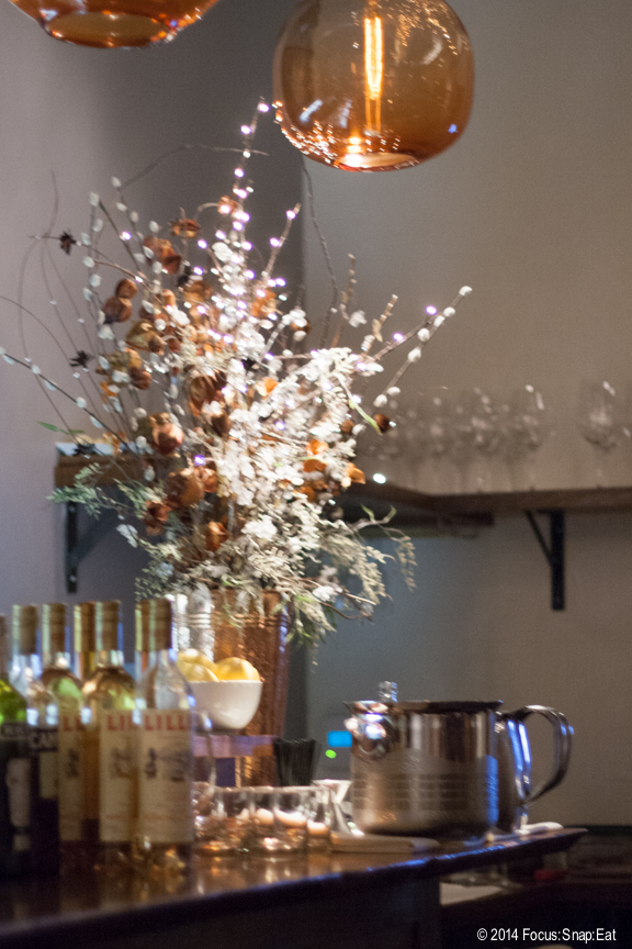 The dining room is minimally decorated, with this big floral display at the bar the only big splashy display.