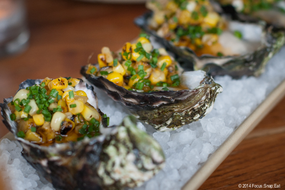 Marin Atlantic oysters spruced up with summer corn and Old Bay butter ($3 each)