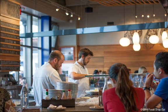 A new U-shaped oyster bar anchors the center for the expanded Hog Island Oyster Co.