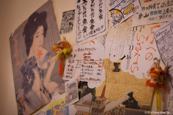 The walls are decorated with eclectic collection of Japanese graphics.
