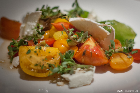 Beautiful last taste of summer heirloom Edge Hill tomatoes with cucumber, basil, and goat cheese ($20)